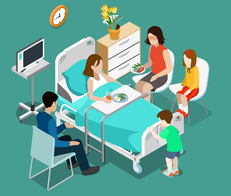 patient in a hospital bed surrounded by family