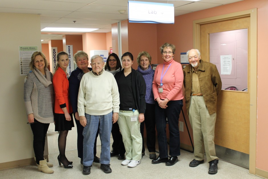 Patient Advisory committee members, men and women standing in a line